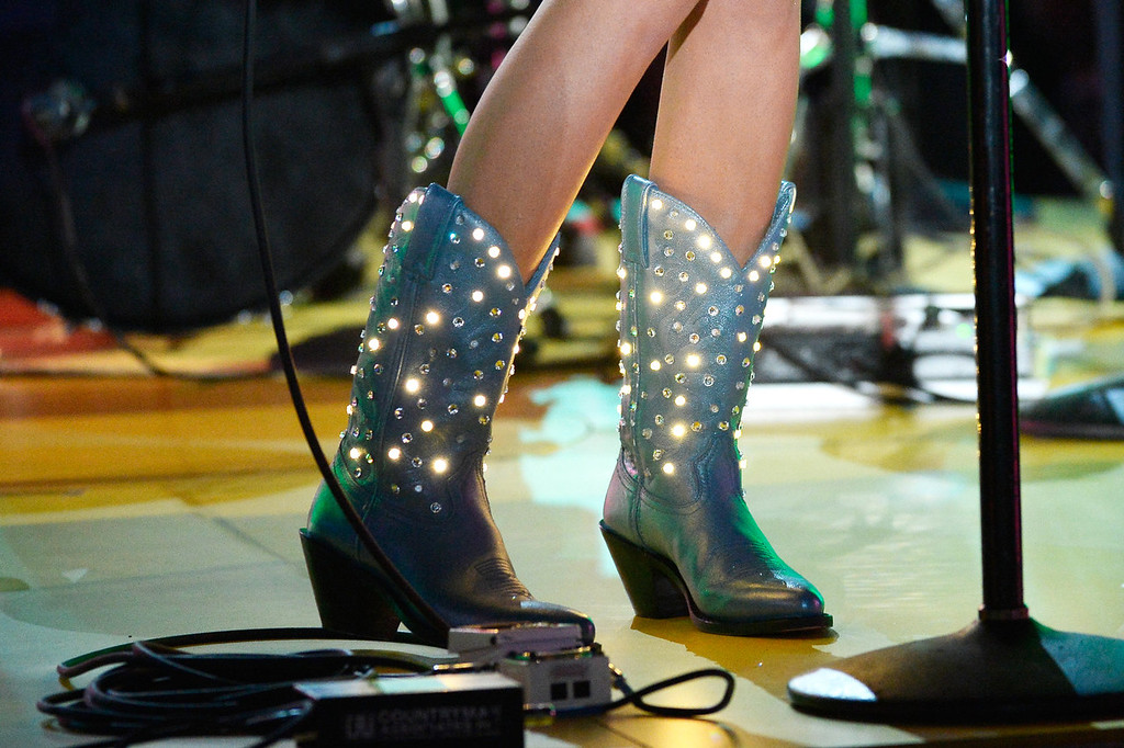 Description of . Singer Kacey Musgraves (boot detail) performs onstage during the 56th GRAMMY Awards at Staples Center on January 26, 2014 in Los Angeles, California.  (Photo by Kevork Djansezian/Getty Images)