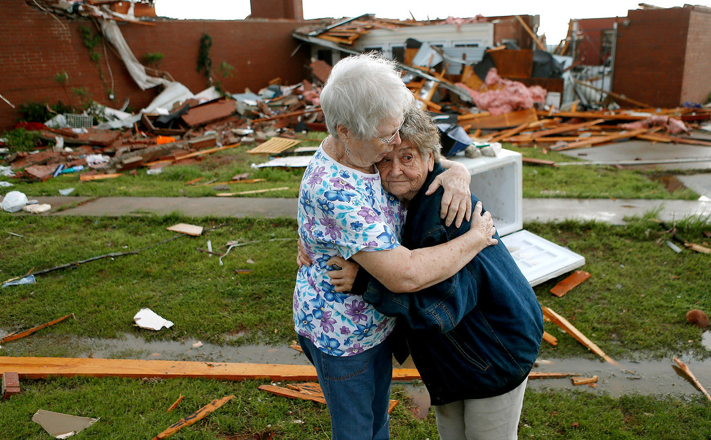 Description of . Jerry Dirks, at right, hugs her friend Earlene Langley after a tornado hit Driks' home just south of Carney Okla., on Sunday, May 19, 2013. Dirks was in her cellar at the time the tornado hit. (AP Photo/The Oklahoman, Bryan Terry)