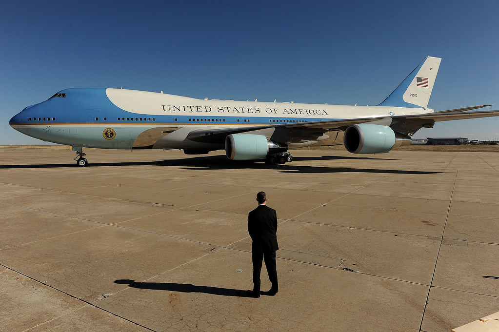 Description of . AURORA, CO- APRIL 3: A member of the advanced security team for President Barack Obama waits as Air Force One gets ready for take-off at Buckley Air Force Base in Aurora, CO  on April 3, 2013.  The president traveled to Colorado to meet with local law enforcement officials and community leaders to discuss the new gun control measures that the state has put in place including loopholes in the back round check system. (Photo By Helen H. Richardson/ The Denver Post) (Photo By Helen H. Richardson/ The Denver Post)