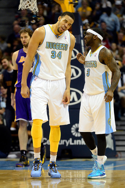 Description of . Denver Nuggets center JaVale McGee (34) reacts to a big dunk with point guard Ty Lawson (3) during the second half of the Nuggets' 126-114 win at the Pepsi Center on Wednesday, December 26, 2012. AAron Ontiveroz, The Denver Post