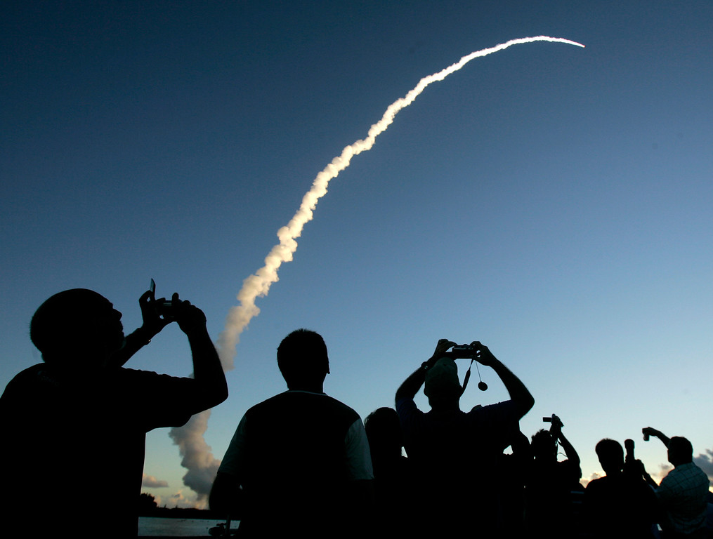 Description of . Spectators at Jetty Park pier watch as a Delta II rocket with the Dawn spacecraft aboard, lifts off from the Cape Canaveral Air Force Station in Cape Canaveral, Fla., Thursday, Sept. 27, 2007. NASA's Dawn spacecraft rocketed away toward an unprecedented double encounter in the asteroid belt between Mars and Jupiter. (AP Photo/John Raoux)