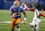 Florida running back Mike Gillislee (23) runs away from the tackle attempt by Louisville linebacker James Burgess (13) in the first half of the Sugar Bowl NCAA college football game Wednesday, Jan. 2, 2013, in New Orleans. (AP Photo/Bill Haber)
