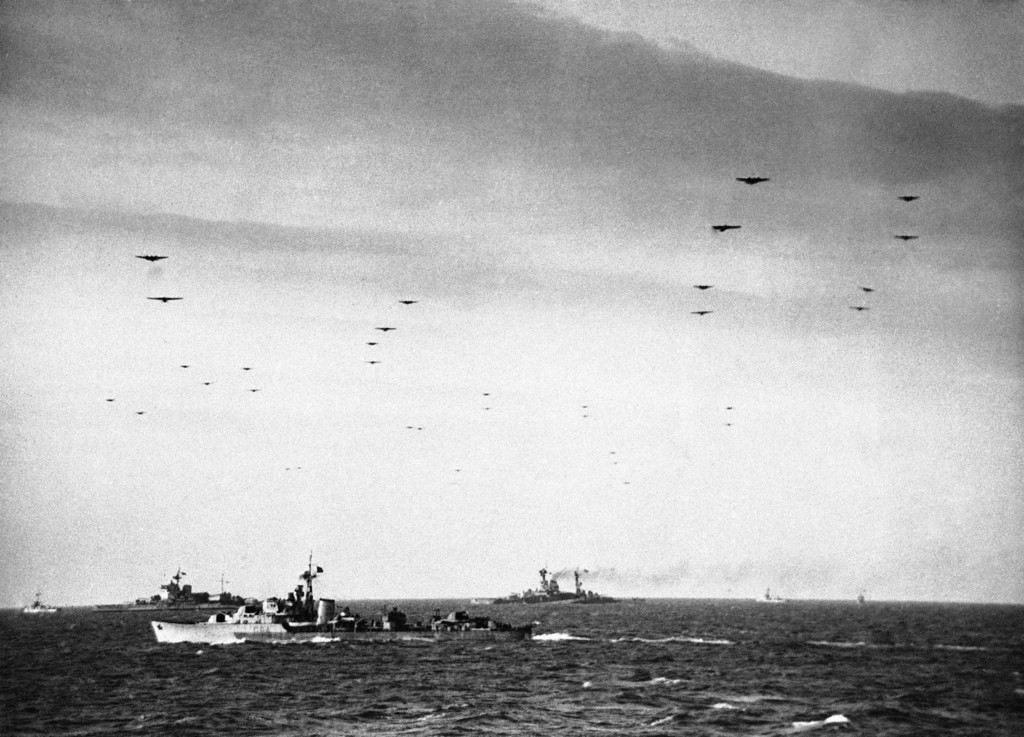 Description of . Glider borne troops crossing the Channel ships of the Royal Navy on June 6, 1944. In the background are the battleships Warspite and Ramillies. (AP Photo)