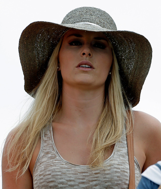 Description of . Skier Lindsey Vonn watches Tiger Woods during the first round of the Masters golf tournament Thursday, April 11, 2013, in Augusta, Ga. (AP Photo/Darron Cummings)
