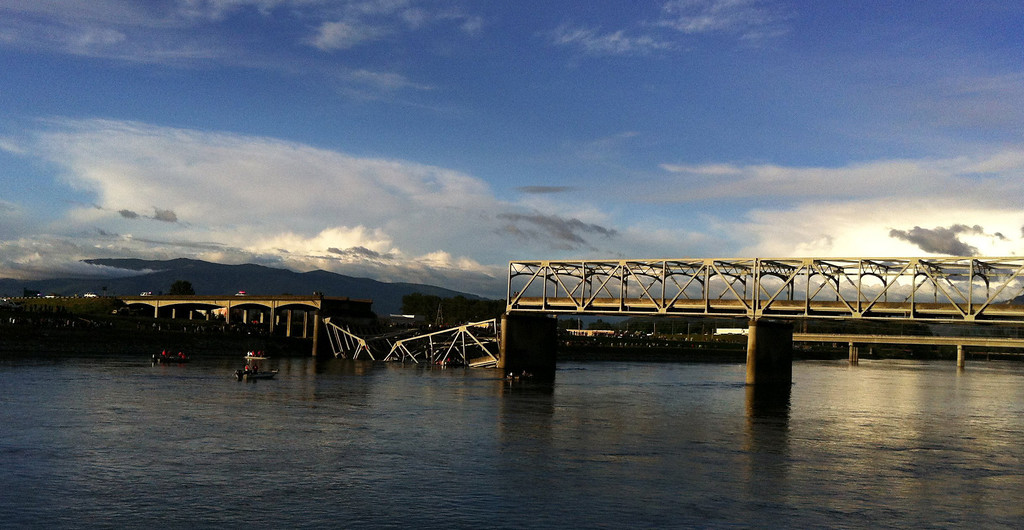 Description of . A portion of the Interstate 5 bridge is submerged after it collapsed into the Skagit River in Mount Vernon, Wash., Thursday, May 23, 2013. (AP Photo/The Seattle Times, Rick Lund)