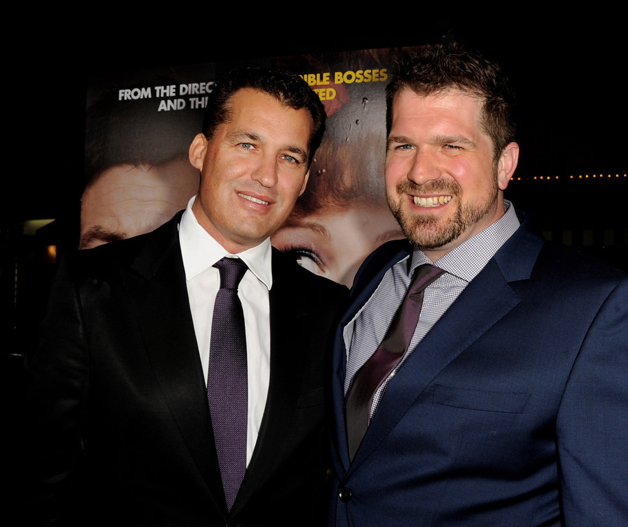 "Description of . Producer Scott Stuber (L) and director Seth Gordon arrive at the premiere of Universal Pictures\' ""Identity Theft\"" at the Village Theatre on February 4, 2013 in Los Angeles, California.  (Photo by Kevin Winter/Getty Images)"