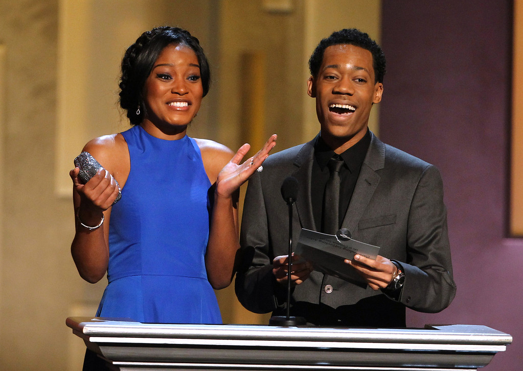 Description of . Keke Palmer, left, and Tyler James Williams present an award at the 44th Annual NAACP Image Awards at the Shrine Auditorium in Los Angeles on Friday, Feb. 1, 2013. (Photo by Matt Sayles/Invision/AP)