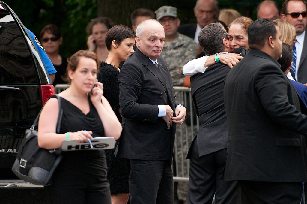 Description of . David Chase (C) attends the funeral for actor James Gandolfini at The Cathedral Church of St. John the Divine on June 27, 2013 in New York City.  (Photo by D Dipasupil/Getty Images)
