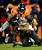 Baltimore Ravens running back Ray Rice (27) is tackled by Denver Broncos cornerback Champ Bailey (24). The Denver Broncos vs Baltimore Ravens AFC Divisional playoff game at Sports Authority Field Saturday January 12, 2013. (Photo by AAron  Ontiveroz,/The Denver Post)