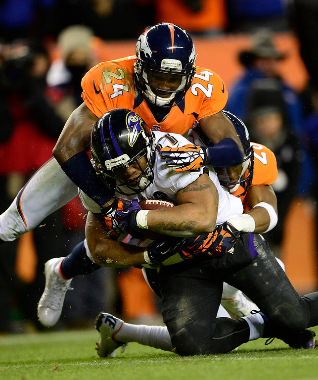 Description of . Baltimore Ravens running back Ray Rice (27) is tackled by Denver Broncos cornerback Champ Bailey (24). The Denver Broncos vs Baltimore Ravens AFC Divisional playoff game at Sports Authority Field Saturday January 12, 2013. (Photo by AAron  Ontiveroz,/The Denver Post)