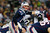 Tom Brady #12 of the New England Patriots makes an adjustment at the line against the Baltimore Ravens during the 2013 AFC Championship game at Gillette Stadium on January 20, 2013 in Foxboro, Massachusetts.  (Photo by Jim Rogash/Getty Images)