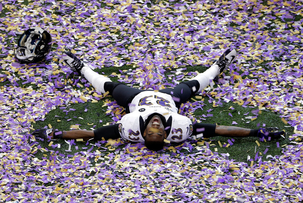 Description of . Baltimore Ravens defensive back Chykie Brown (23) celebrates after the NFL Super Bowl XLVII football game against the San Francisco 49ers, Sunday, Feb. 3, 2013, in New Orleans. The Ravens won 34-31. (AP Photo/Charlie Riedel)