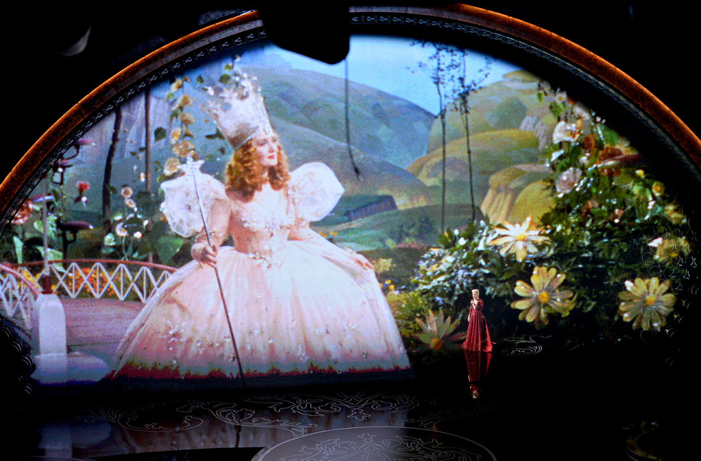 Description of . Video tribute to 'The Wizard of Oz' onstage during the Oscars at the Dolby Theatre on March 2, 2014 in Hollywood, California.  (Photo by Kevin Winter/Getty Images)