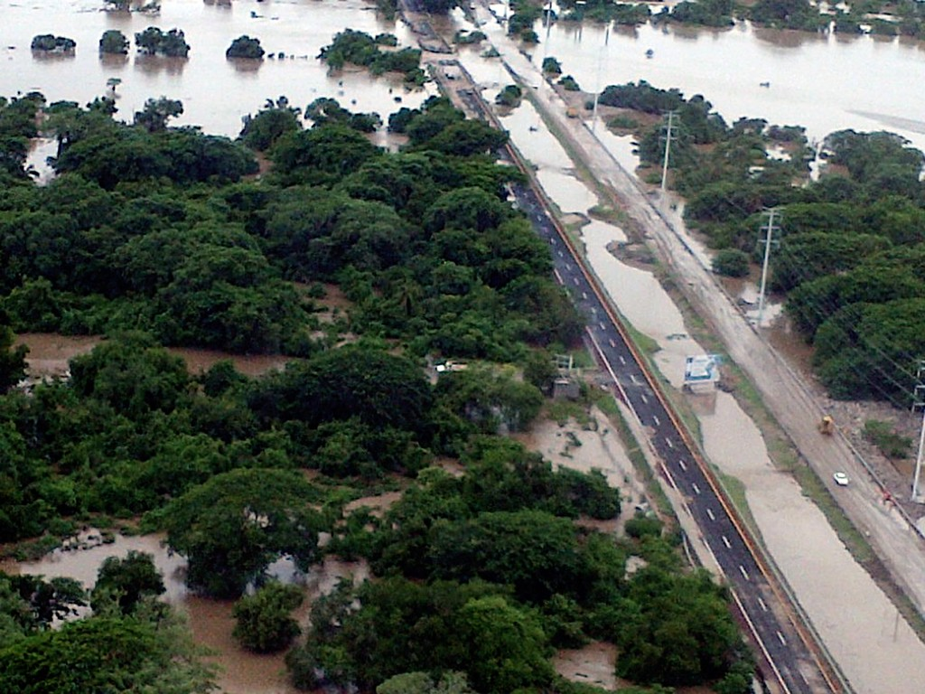 Description of . This handout photo taken and released on September 18, 2013 by Mexico's Interior Ministry press office shows an aerial view of flooding along the highway going to Acapulco, in the Mexican state of Guerrero, as heavy rains hit the country.     AFP PHOTO/ Interior MINISTRY -AFP/Getty Images