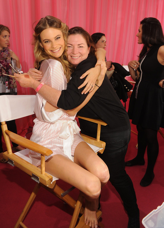Description of . Victoria's Secret model Behati Prinsloo and makeup artist Coleen Creighton pose at the 2013 Victoria's Secret Fashion Show hair and makeup room at Lexington Avenue Armory on November 13, 2013 in New York City.  (Photo by Jamie McCarthy/Getty Images)