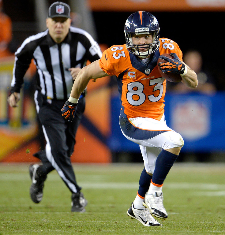 . Denver Broncos wide receiver Wes Welker (83) runs with the ball after catching a pass during the second quarter. The Denver Broncos took on the Oakland Raiders at Sports Authority Field at Mile High in Denver on September 23, 2013. (Photo by Joe Amon/The Denver Post)