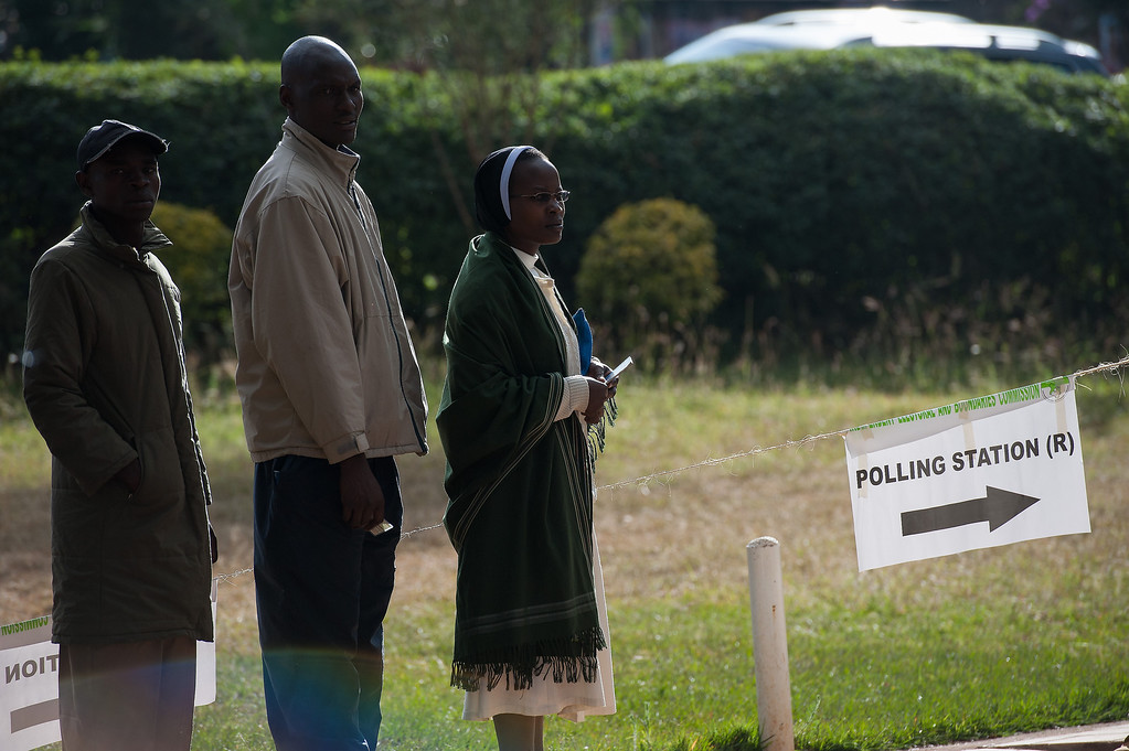 Description of . Voters queue to cast their ballot at St. Matthews church in the Langata constituency of the Kenyan capital, Nairobi, on March 4, 2013 during the elections. Long lines of Kenyans queued from far before dawn to vote Monday in the first election since the violence-racked polls five years ago, with a deadly police ambush hours before polling started marring the key ballot. The tense elections are seen as a crucial test for Kenya, with leaders vowing to avoid a repeat of the bloody 2007-8 post-poll violence in which over 1,100 people were killed, with observers repeatedly warning of the risk of renewed conflict.     PHIL MOORE/AFP/Getty Images