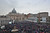 People wait under rain at St Peter' square during the conclave on March 13, 2013 at the Vatican.   AFP PHOTO TIZIANA FABI/AFP/Getty Images