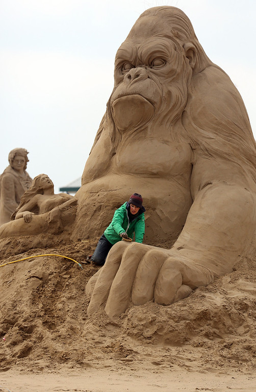 . Sand sculptor Helena Bangert (C), from Holland works on a sand sculpture of King Kong as pieces are prepared as part of this year�s Hollywood themed annual Weston-super-Mare Sand Sculpture festival on March 26, 2013 in Weston-Super-Mare, England. Due to open on Good Friday, currently twenty award winning sand sculptors from across the globe are working to create sand sculptures including Harry Potter, Marilyn Monroe and characters from the Star Wars films as part of the town\'s very own movie themed festival on the beach.  (Photo by Matt Cardy/Getty Images)