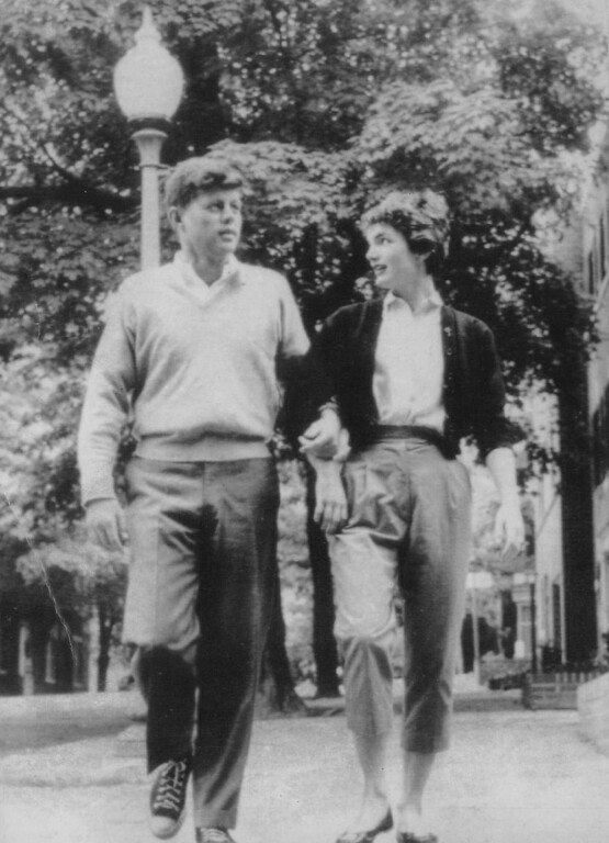 Description of . Kennedy and Jacqueline stroll arm-in-arm in early 1953. Kennedy had won a U.S. Senate seat in 1952,  and the couple were married in 1953. Denver Post file