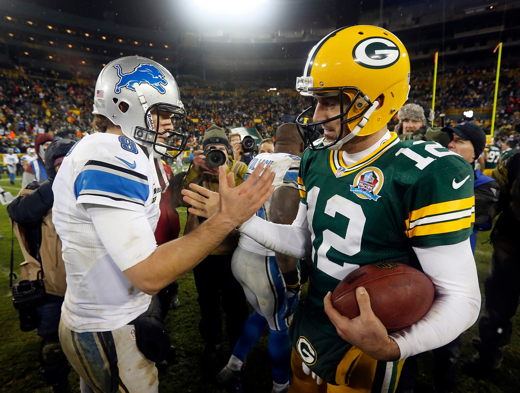 Description of . Green Bay Packers quarterback Aaron Rodgers (12) shakes hands with Detroit Lions quarterback Matthew Stafford (9) after an NFL football game Sunday, Dec. 9, 2012, in Green Bay, Wis. The Packers won 27-20. (AP Photo/Mike Roemer)