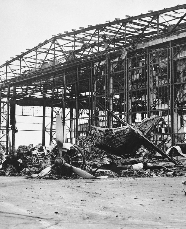 Description of . One of the hangars that was burned out at the Naval Air Station on Ford Island, Pearl Harbor, Dec. 7, 1941. (AP Photo)