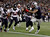New England Patriots tight end Aaron Hernandez scores a touchdown past Houston Texans linebackers Darryl Sharpton (51), Tim Dobbins (52) and Whitney Mercilus (59) during the first half of their NFL football game in Foxborough, Massachusetts December 10, 2012. REUTERS/Jessica Rinaldi