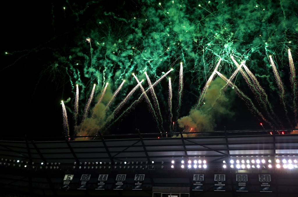 Description of . Fireworks go off as former Philadelphia Eagles quarterback Donovan McNabb's number '5' is unveiled and retired at halftime of the game between the Philadelphia Eagles and the Kansas City Chiefs at Lincoln Financial Field on September 19, 2013 in Philadelphia, Pennsylvania.  (Photo by Elsa/Getty Images)