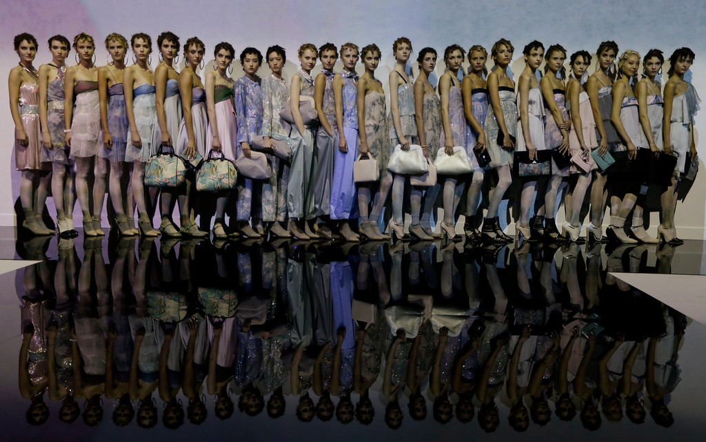 Description of . Models show creations for Emporio Armani women's Spring-Summer 2014 collection, part of the Milan Fashion Week, unveiled in Milan, Italy, Friday, Sept. 20, 2013. (AP Photo/Luca Bruno)