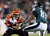 Dan Herron #34 of the Cincinnati Bengals carries the ball as  Marvin McNutt #83 of the Philadelphia Eagles defends on December 13, 2012 at Lincoln Financial Field in Philadelphia, Pennsylvania. Herron recovered a blocked punt. (Photo by Elsa/Getty Images)