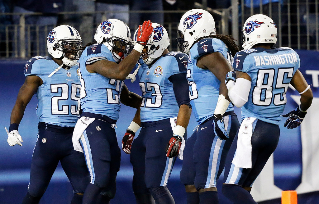 Description of . Tennessee Titans running back Chris Johnson, second from left, celebrates with teammates including running back Darius Reynaud (25), running back Jamie Harper (23) and wide receiver Nate Washington (85) after running for a 94-yard touchdown against the New York Jets in the second quarter of an NFL football game, Monday, Dec. 17, 2012, in Nashville, Tenn. (AP Photo/Wade Payne)