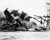 The battleship USS Arizona belches smoke as it topples over into the sea during Japanese surprise attack on Pearl Harbor, Hawaii, December 7, 1941. The ship sank with more than 80 percent of its 1,500-man crew, including Rear Admiral Issac C. Kidd. The attack, which left 2,343 Americans dead and 916 missing, broke the backbone of the U.S. Pacific Fleet and forced America out of a policy of isolationism. President Franklin D. Roosvelt announced that it was 