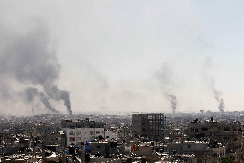 Description of . Smoke billows from buildings following an Israeli military strike east of Rafah in the southern Gaza Strip, on August 1, 2014. Israeli shelling killed eight people in southern Gaza, medics said, just hours after a 72-hour humanitarian ceasefire took effect. AFP PHOTO/ SAID KHATIB/AFP/Getty Images