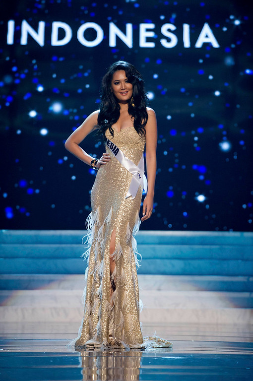 Description of . Miss Indonesia 2012 Maria Selena competes in an evening gown of her choice during the Evening Gown Competition of the 2012 Miss Universe Presentation Show in Las Vegas, Nevada December 13, 2012. The Miss Universe 2012 pageant will be held on December 19 at the Planet Hollywood Resort and Casino in Las Vegas. REUTERS/Darren Decker/Miss Universe Organization L.P/Handout