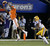 Clemson wide receiver DeAndre Hopkins (6) makes a catch against LSU cornerback Jalen Mills (28) watches during the first half of the Chick-fil-A Bowl NCAA college football game, Monday, Dec. 31, 2012, in Atlanta. (AP Photo/David Goldman)