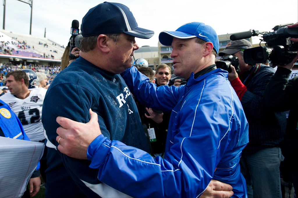 Description of . Head Coach David Bailiff of the Rice Owls (left) and Head coach Troy Calhoun of the Air Force Falcons exchange words after the Bell Helicopter Armed Forces Bowl on December 29, 2012 at Amon G. Carter Stadium in Fort Worth, Texas.  (Photo by Cooper Neill/Getty Images)