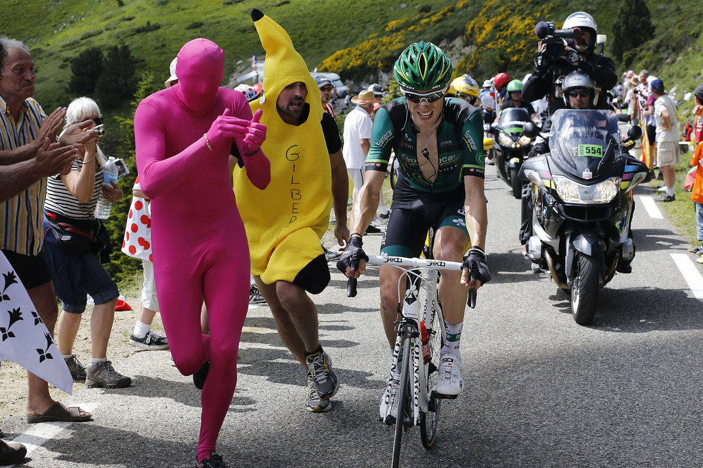 Description of . France's Pierre Rolland rides as disguised supporters run next him during the 195 km eighth stage of the 100th edition of the Tour de France cycling race on July 6, 2013 between Castres and Ax 3 Domaines, southwestern France.  PASCAL GUYOT/AFP/Getty Images