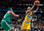 Denver Nuggets forward Corey Brewer, right, slips past Boston Celtics forward Paul Pierce for a shot  in the fourth quarter of the Nuggets' 97-90 victory in an NBA basketball game in Denver on Tuesday, Feb. 19, 2013. (AP Photo/David Zalubowski)