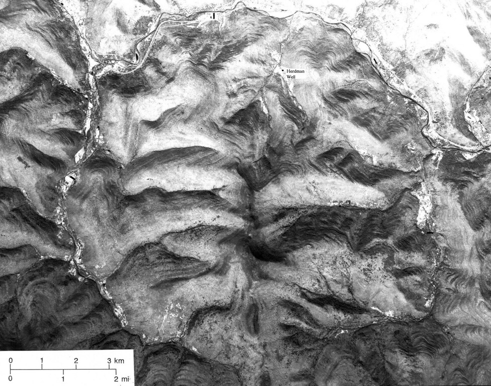 Description of . This is a 1976 aerial of Panther Mountain ringed by the Esopus and Woodland Creeks about 20 miles northwest of Kingston, N.Y. State geologist Yngavar Ishachsen believes the unusual circular valley is the result of an asteroid impact roughly 300 million years ago. (AP Photo/NASA)