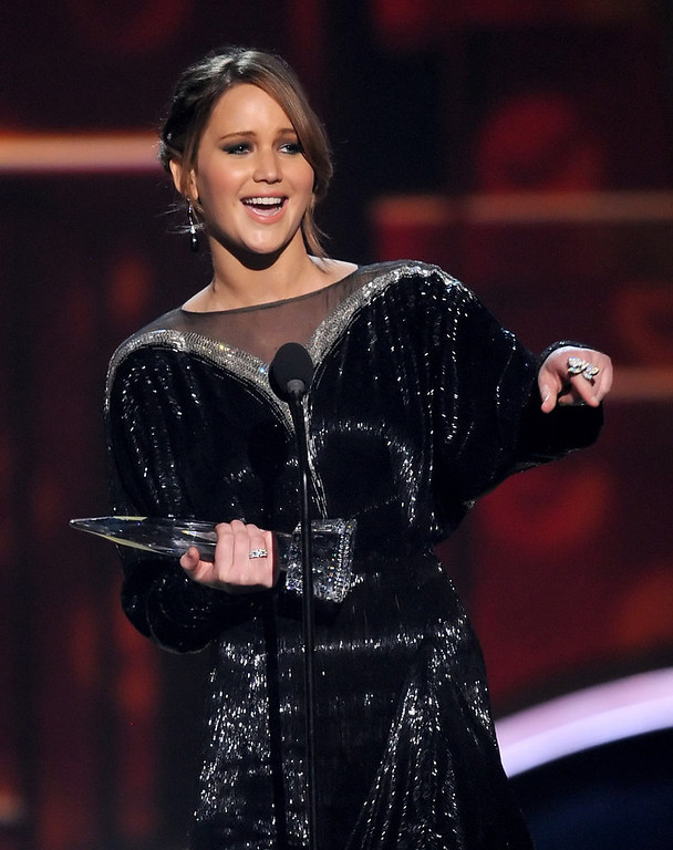 Description of . Actress Jennifer Lawrence, winner of Favorite Movie Actress, speaks onstage at the 39th Annual People's Choice Awards  at Nokia Theatre L.A. Live on January 9, 2013 in Los Angeles, California.  (Photo by Kevin Winter/Getty Images for PCA)