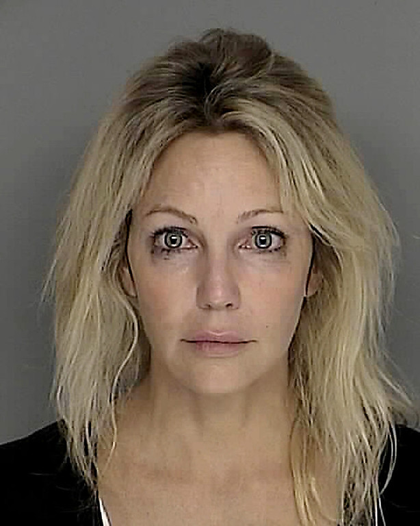 Description of . Actress Heather Locklear is shown in this photograph released by the Santa Barbara County Sheriff's Dept. Sunday, Sept. 28, 2008, in Santa Barbara, Calif. Locklear was arrested on suspicion of driving under the influence of a controlled substance in the upscale Santa Barbara area, authorities said Sunday. (AP Photo/Santa Barbara County Sheriff's Dept.)