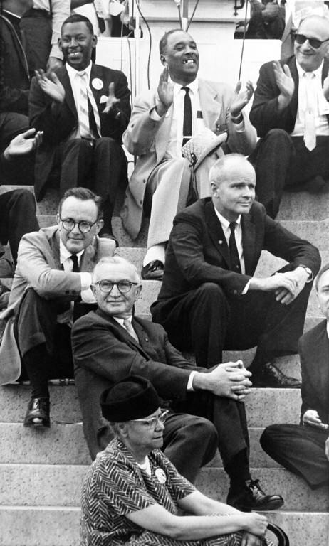 Description of . Three members of the Senate make up part of the audience at the Lincoln Memorial ceremonies of the civil rights March on Washington in Washington on August 28, 1963. The senators are, from left: Phillip Hart, D-Mich., Wayne Morse, D-Ore., and William Proxmire, D-Wis. (AP Photo)