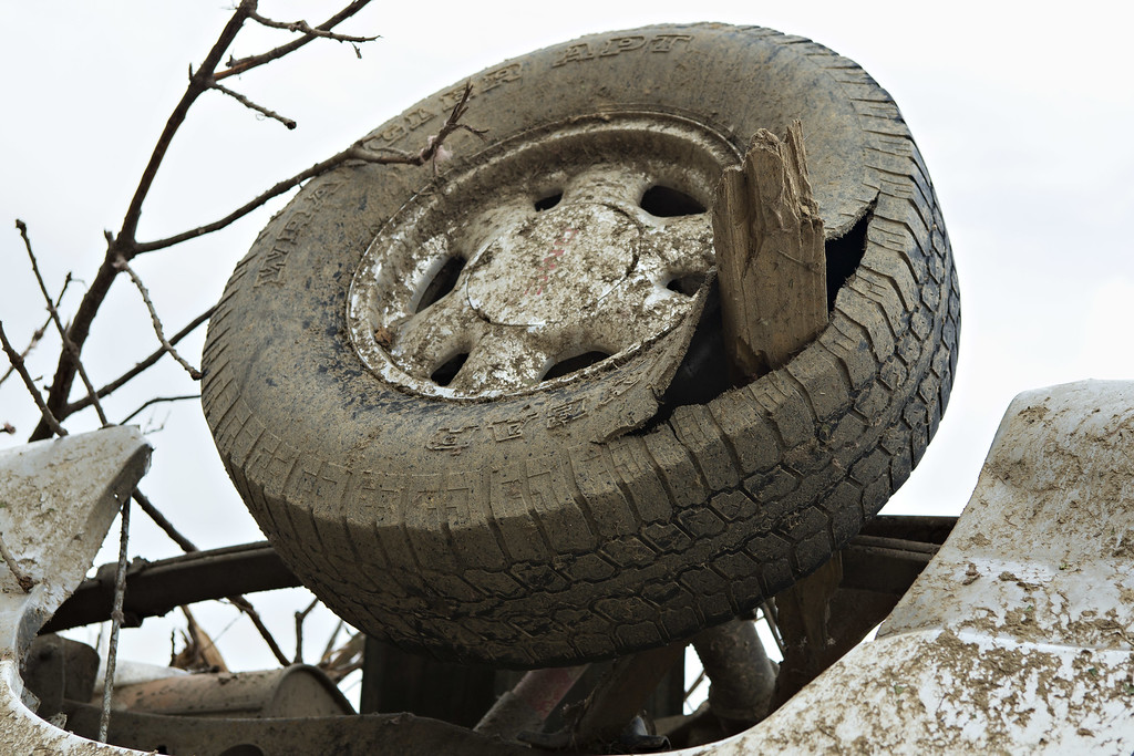 Description of . Tire punctured  by a board sits upside down after a strong tornado went through the area on April 27 for the second time in three years on April 28, 2014 in Vilonia, Arkansas. After deadly tornadoes ripped through the area and have left over a dozen dead, Mississippi, Arkansas, Texas, Louisiana, and Tennessee are all under watch as multiple storms over the next few days are expected.  (Photo by Wesley Hitt/Getty Images)