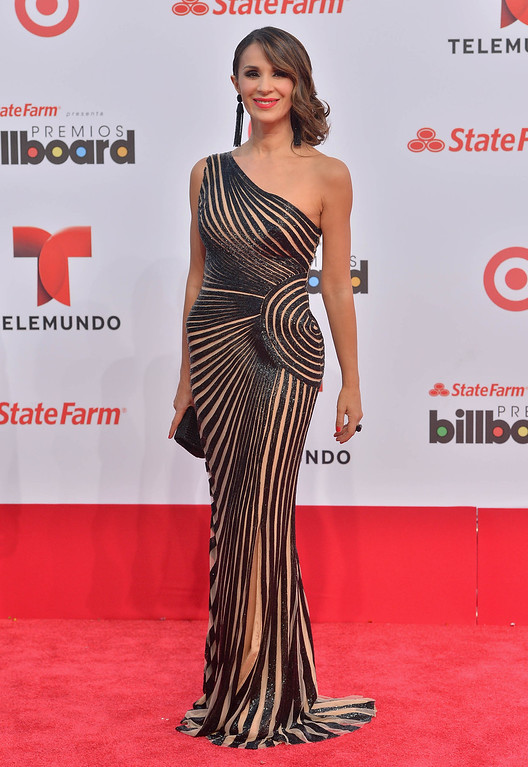 Description of . MIAMI, FL - APRIL 25:  Catherine Siachoque arrives at Billboard Latin Music Awards 2013 at Bank United Center on April 25, 2013 in Miami, Florida.  (Photo by Gustavo Caballero/Getty Images)