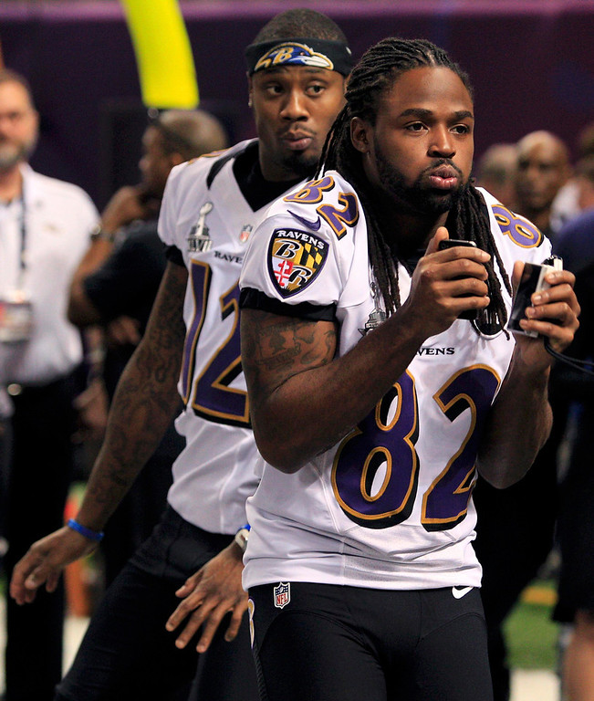 Description of . Baltimore Ravens wide receiver Jacoby Jones (12) and Torrey Smith (82) arrive for Media Day for the NFL's Super Bowl XLVII in New Orleans, Louisiana January 29, 2013. The San Francisco 49ers will meet the Ravens in the game on February 3. REUTERS/Sean Gardner