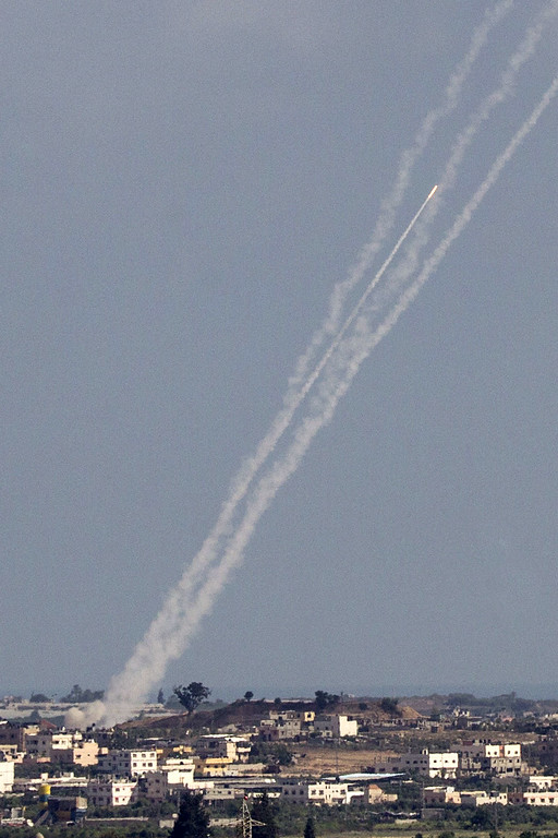 Description of . A picture taken from the Israeli border with the Gaza Strip shows rockets being launched from Gaza towards Israel on July 16, 2014. New Israeli air and tank strikes in Gaza killed several people today, medics said, bringing the death toll from Israel's operation in the besieged Palestinian territory to 205. Since the latest violence began before dawn on July 8, 990 rockets fired from Gaza have struck Israel, and another 244 have been shot down by the Iron Dome anti-missile system, army figures show.  AFP PHOTO / JACK GUEZ/AFP/Getty Images