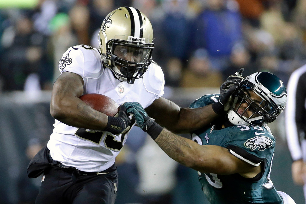 Description of . New Orleans Saints' Khiry Robinson, left, tries to break free of Philadelphia Eagles' Mychal Kendricks during the first half of an NFL wild-card playoff football game, Saturday, Jan. 4, 2014, in Philadelphia. (AP Photo/Matt Rourke)