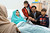 Malala Yousufzai is seen with her father Ziauddin and her two younger brothers Khushal Khan and Atal Khan (R), as she recuperates at the The Queen Elizabeth Hospital in Birmingham, in this photograph taken October 25, 2012 and released October 26, 2012. The father of a Pakistani girl who was shot in the head by the the Taliban for advocating girls' education said on Friday his daughter was strong and would 