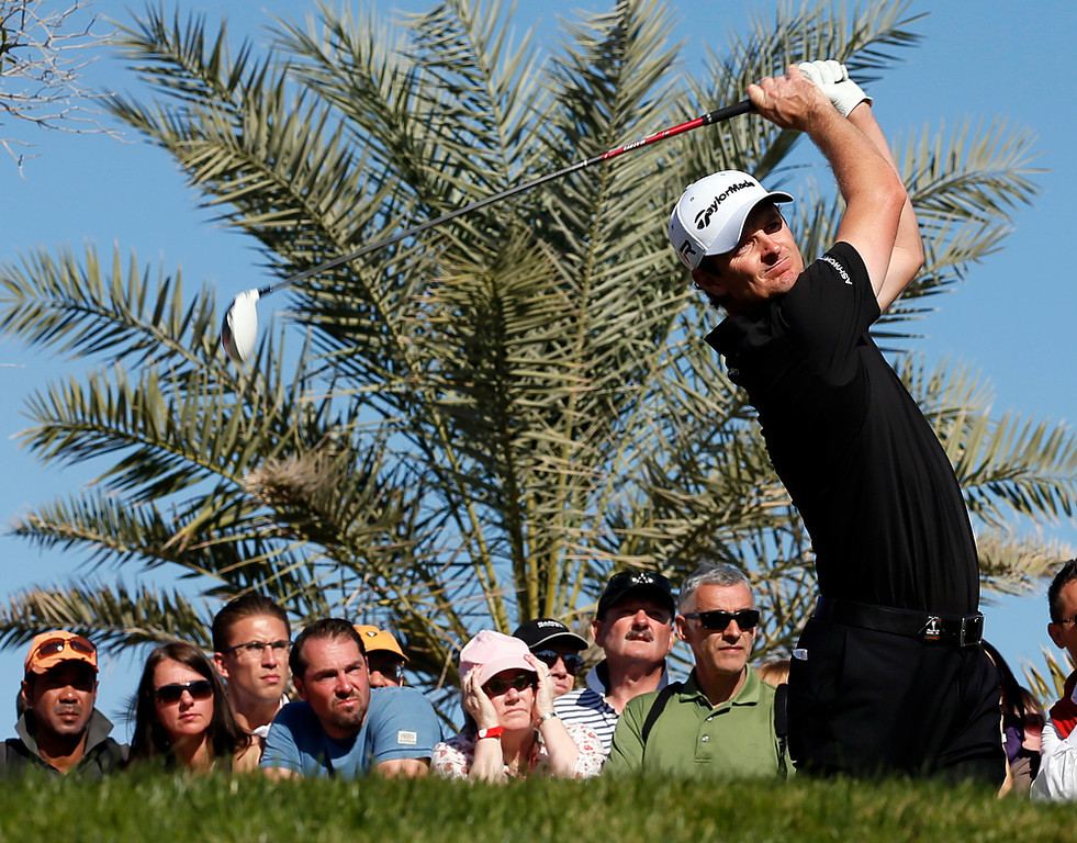 Description of . England's Justin Rose plays a shot during the second round of the Abu Dhabi Golf Championship at the Abu Dhabi Golf Club in the Emirati capital on January 18, 2013. AFP PHOTO/KARIM SAHIBKARIM SAHIB/AFP/Getty Images
