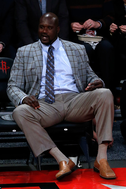 Description of . HOUSTON, TX - FEBRUARY 15:  Head coach Shaquille O'Neal of Team Shaq reacts in the BBVA Rising Stars Challenge 2013 part of the 2013 NBA All-Star Weekend at the Toyota Center on February 15, 2013 in Houston, Texas.   (Photo by Scott Halleran/Getty Images)